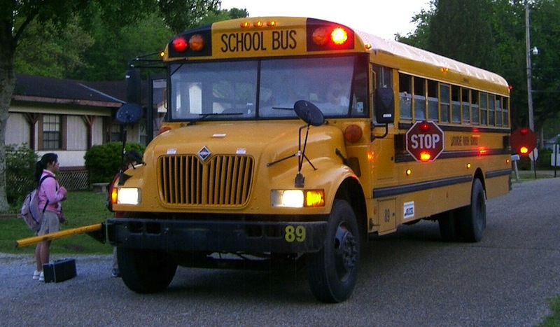 Passing a stopped school bus can land you a ticket for $400 plus five points for a first offense. Photo courtesy Wikimedia Commons.